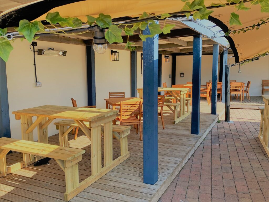 Birley Arms Hotel Warton pub beer garden covered seating area for outside drinking and dining